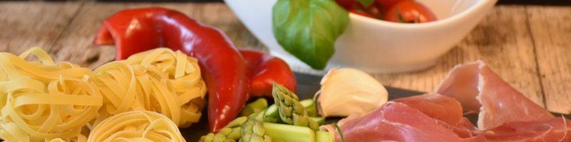 italian food pasta fettucini peppers asparagus garlic basil tomato